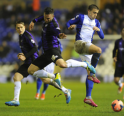 Birmingham City's Paul Caddis battles for the ball with Bristol Rovers' Chris Beardsley - Photo mandatory by-line: Joe Meredith/JMP - Tel: Mobile: 07966 386802 14/01/2014 - SPORT - FOOTBALL - St Andrew's Stadium - Birmingham - Birmingham City v Bristol Rovers - FA Cup - Third Round