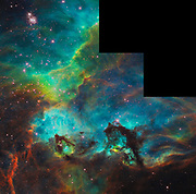Star Cluster NGC 2074 in the Large Magellanic Cloud. A small portion of the nebula near the star cluster NGC 2074 (upper, left). The region is a firestorm of raw stellar creation, perhaps triggered by a nearby supernova explosion. It lies about 170,000 light-years away near the Tarantula nebula, one of the most active star-forming regions in our Local Group of galaxies. The three-dimensional-looking image reveals dramatic ridges and valleys of dust, serpent-head 'pillars of creation,' and gaseous filaments glowing fiercely under torrential ultraviolet radiation. The seahorse-shaped pillar at lower, right is approximately 20 light-years long, roughly four times the distance between our Sun and the nearest star, Alpha Centauri. The region is in the Large Magellanic Cloud (LMC), a satellite of the Milky Way galaxy. This representative color image was taken on August 10, 2008, with Hubble's Wide Field Planetary Camera 2. Red shows emission from sulfur atoms, green from glowing hydrogen, and blue from glowing oxygen.
