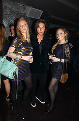 Left to right, ANNABELLE RITCHIE, EDWARD TANG and GEORGINA HONOUR at a party to celebrate the opening of Kitts nightclub, 7-12 Sloane Square, London on 7th December 2006.<br />