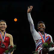 Simone Biles, Spring, Texas, (right), on the podium with Kyla Ross, Aliso Viejo, California, after winning the All-Round title during the Senior Women Competition at The 2013 P&G Gymnastics Championships, USA Gymnastics' National Championships at the XL, Centre, Hartford, Connecticut, USA. 17th August 2013. Photo Tim Clayton