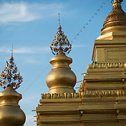 Built by King Mindon in 1857 at the foot of Mandalay Hill, Kuthodaw Pagoda houses what is known as The World's Largest Book, which consists of 729 kyauksa gu or stone-inscription caves, each containing a marble slab inscribed on both sides with a page of text from the Tipitaka, the entire Pali Canon of Theravada Buddhism.
