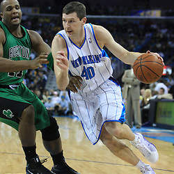 11 February 2009: New Orleans Hornets forward Ryan Bowen (40) drives past Boston Celtics forward Glen Davis (11) during a 89-77 loss by the New Orleans Hornets to the Boston Celtics at the New Orleans Arena in New Orleans, LA.