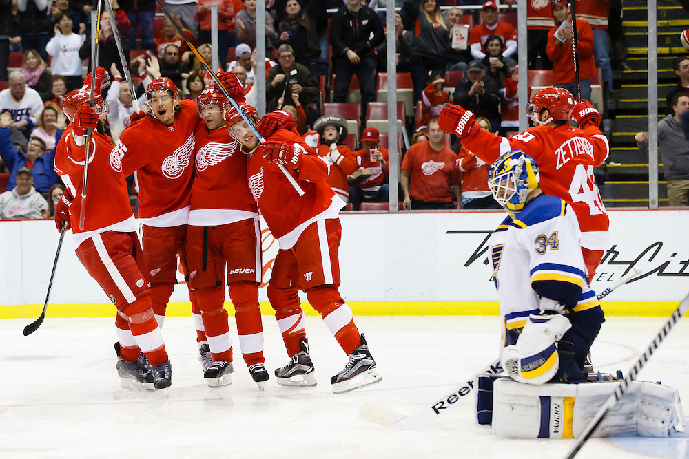 Mar 22, 2015; Detroit, MI, USA; Detroit Red Wings right wing Erik Cole (third from left) receives congratulations from teammates after scoring on St. Louis Blues goalie Jake Allen (34) in the third period at Joe Louis Arena. Detroit won 2-1 in overtime. Mandatory Credit: Rick Osentoski-USA TODAY Sports
