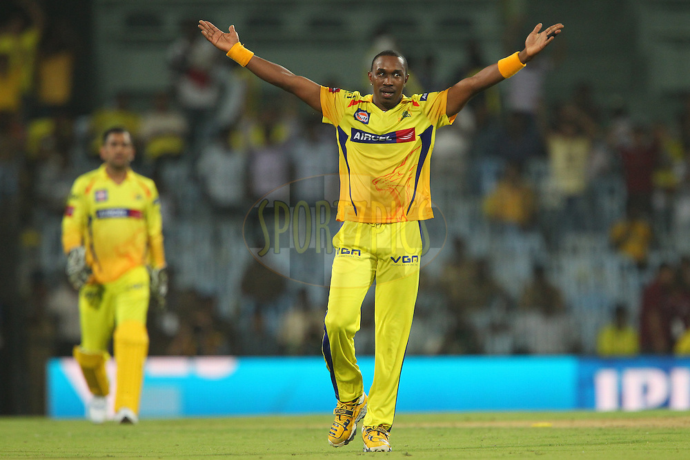 Dwayne Bravo bowls Irfan Patahn to regain the purple cap during match 64 of the Pepsi Indian Premier League between The Chennai Superkings and the Delhi Daredevils held at the MA Chidambaram Stadium in Chennai on the 14th May 2013..Photo by Ron Gaunt-IPL-SPORTZPICS   .. .Use of this image is subject to the terms and conditions as outlined by the BCCI. These terms can be found by following this link:..http://www.sportzpics.co.za/image/I0000SoRagM2cIEc
