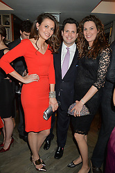 Left to right, siblings OLIVIA COLE, HARRY COLE and his GEORGINA COLE at the 3rd birthday party for Spectator Life magazine hosted by Andrew Neil and Olivia Cole held at the Belgraves Hotel, 20 Chesham Place, London on 31st March 2015.