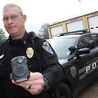 RAY VAN DUSEN/BUY AT PHOTOS.MONROECOUNTYJOURNAL.COM<br /> Nettleton Assistant Police Chief Joseph Beasley holds a body camera, the newest of equipment for the department. Thanks to two different grants, the NPD is able to purchase 10 body cameras and two tasers.