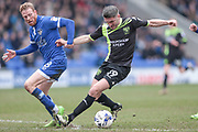 Ryan Lowe (Bury) controls the ball while Paul Green (Oldham Athletic) watches during the EFL Sky Bet League 1 match between Oldham Athletic and Bury at Boundary Park, Oldham, England on 11 March 2017. Photo by Mark P Doherty.