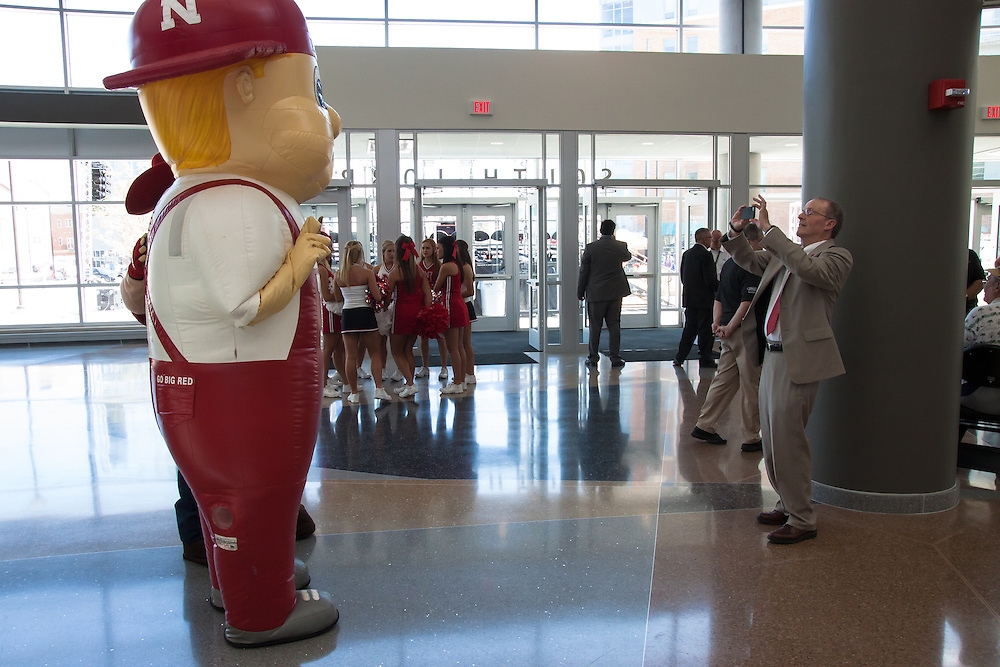 August 29, 2013: Nebraska Chancellor Harvey Perlman snaps a photo of Lil' Red and Herbie before the ribbon cutting at the Pinnacle Bank Arena in Lincoln, Nebraska.