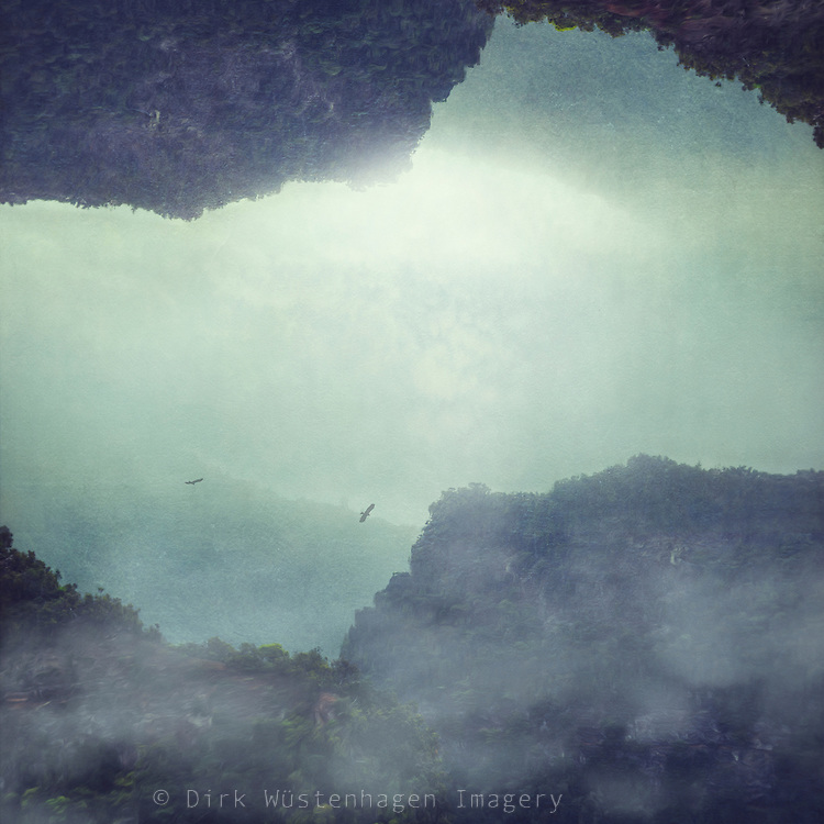 Photomanipulation - surreal mountaineous landscape with fog and birds<br />