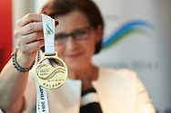 Anna Wasilewska member of board of Warmia Mazury Region holds gold medal during press conference at Polish Olympic Committee in Warsaw, Poland.<br /> <br /> Poland, Warsaw, August 27, 2014<br /> <br /> Picture also available in RAW (NEF) or TIFF format on special request.<br /> <br /> For editorial use only. Any commercial or promotional use requires permission.<br /> <br /> Photo by © Adam Nurkiewicz / Mediasport