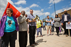 Luton, UK. 27th June, 2015. Former councillor Jim Thakoordin addresses local residents and anti-racist activists from Unite Against Fascism at a counter-protest against a march by far-right group Britain First. A large police presence kept the two groups apart.
