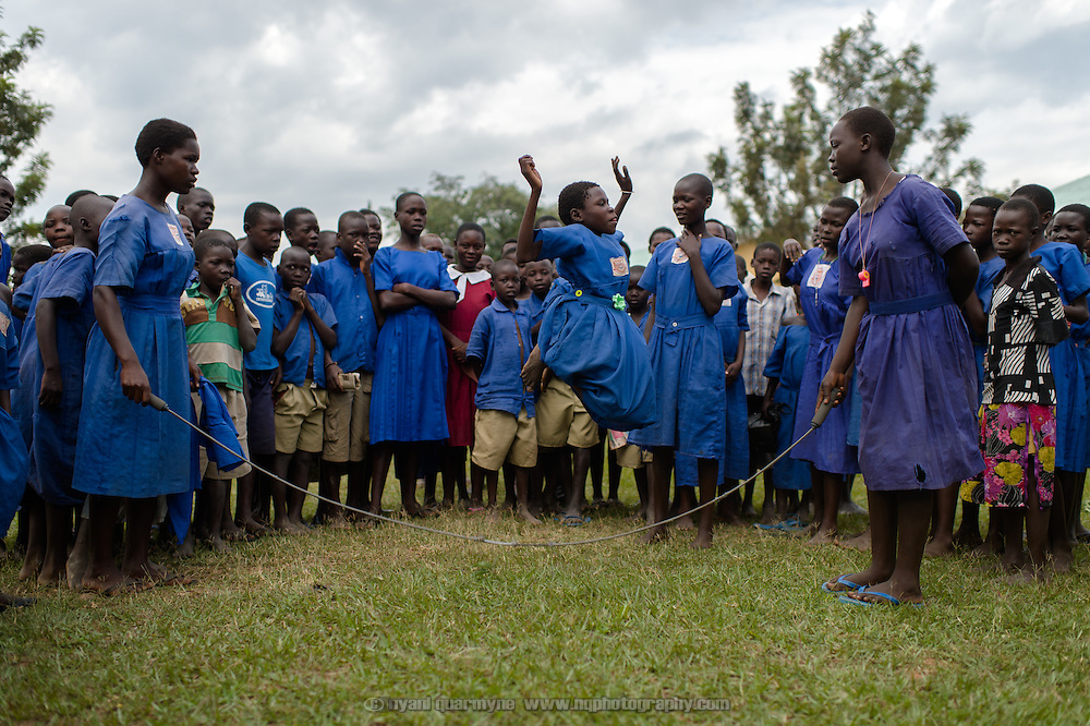 Girls skipping at Aputiri Primary School in Eastern Uganda on 31 July 2014. The school participates in a Menstrual Health Management program supported by Plan International, which includes the distribution of reusable sanitary pads made in Uganda by Afripads. Teachers report that absenteeism has fallen sharply, as girls who used rags or cotton wool previously would stay home for fear of leakage and embarrassment. Girls who use Afripads say that they are more comfortable now, and can run and play which they were afraid to do before when they had their periods.