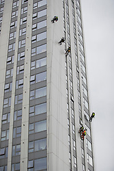 © Licensed to London News Pictures. 27/06/2017. London, UK. Specialists abseil down the face of Bray tower block to inspect cladding on the Chalcots Estate in Camden after it failed a fire inspection because of combustable cladding. More than 700 flats in tower blocks on an estate in the Swiss Cottage area of north-west London are being evacuated because of fire safety concerns after the Grenfell Tower fire of on June 14. Photo credit: Peter Macdiarmid/LNP
