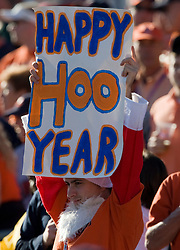 "A Virginia fan dressed as Santa Claus holds up a sign that reads ""Happy Hoo Year"" during the Gator Bowl.  The Texas Tech Red Raiders defeated the Virginia Cavaliers 31-28 in the 2008 Konica Menolta Gator Bowl held at the Jacksonville Municipal Stadium in Jacksonville, FL on January 1, 2008."