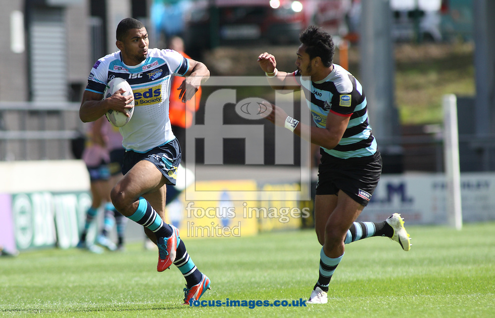 Denny Solomona (R) of London Broncos tackles Kallum Watkins (L) of Leeds Rhinos during the First Utility Super League match at The Hive Stadium, Harrow<br /> Picture by Stephen Gaunt/Focus Images Ltd +447904 833202<br /> 17/08/2014