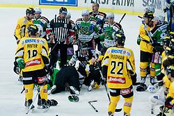 Fight between Miha Verlic (HDD Tilia Olimpija, #91) and Taylor Holst (UPC Vienna Capitals, #94) during of ice-hockey match between HDD Tilia Olimpija and UPC Vienna Capitals in 8th Round of EBEL league, on October 2, 2011 at Hala Tivoli, Ljubljana, Slovenia. (Photo By Matic Klansek Velej / Sportida)