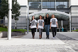 "© Licensed to London News Pictures. 13/10/2012. London, UK. Campaigners (left to right: Joanna Cheetham, Lucy Anne Holmes, Pavan Amara and Sarah Anderson) leave the News International offices in Wapping after delivering a letter to Dominic Mohan, editor of The Sun newspaper demanding an end to topless models on Page 3. An online petition started by Lucy Holmes is campaigning to ""Take the bare boobs out of The Sun"". Photo credit : Vickie Flores/LNP"