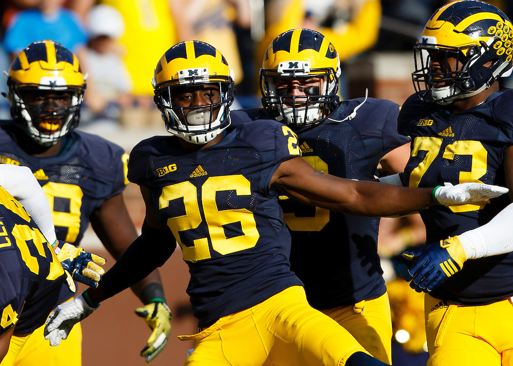 Oct 10, 2015; Ann Arbor, MI, USA; Michigan Wolverines cornerback Jourdan Lewis (26) celebrates with teammates after he scores a touchdown on an interception in the second quarter against the Northwestern Wildcats at Michigan Stadium. Mandatory Credit: Rick Osentoski-USA TODAY Sports