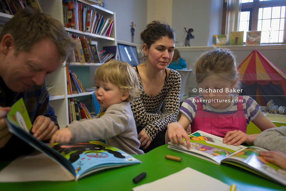 In the final hours before the closure, locals use the facilities of Carnegie Library, Herne Hill, SE24, in the south London borough of Lambeth, which has angered the local community who have occupied their important resouce for learning and social hub. After a long campaign by locals, Lambeth council have gone ahead and closed the library's doors for the last time at 6pm because, they say, cuts to their budget mean millions must be saved. A gym will replace the working library and while some of the 20,000 books on shelves will remain, no librarians will be present to administer it. London borough's budget cuts mean four of its 10 libraries will either close, move or be run by volunteers.