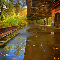 An old S-Bahn station unused since the 80s near Berlin with reflections in water