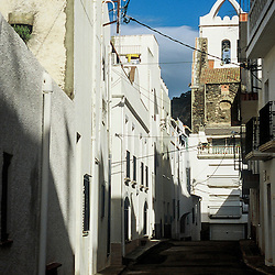 In the summer the streets of Port de la Selva, one of Costa Brava's best beach towns, is full of people but, in the winter only the sun and the buildings hang around.