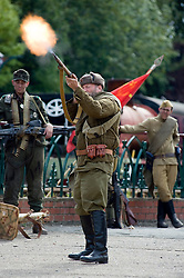 A re-enactor dressed as a Soviet soldier from the Russian 13th Guards Rifle Division takes part in a living history firing display at the Elsecar Heritage Centre 1940s Weekend<br />