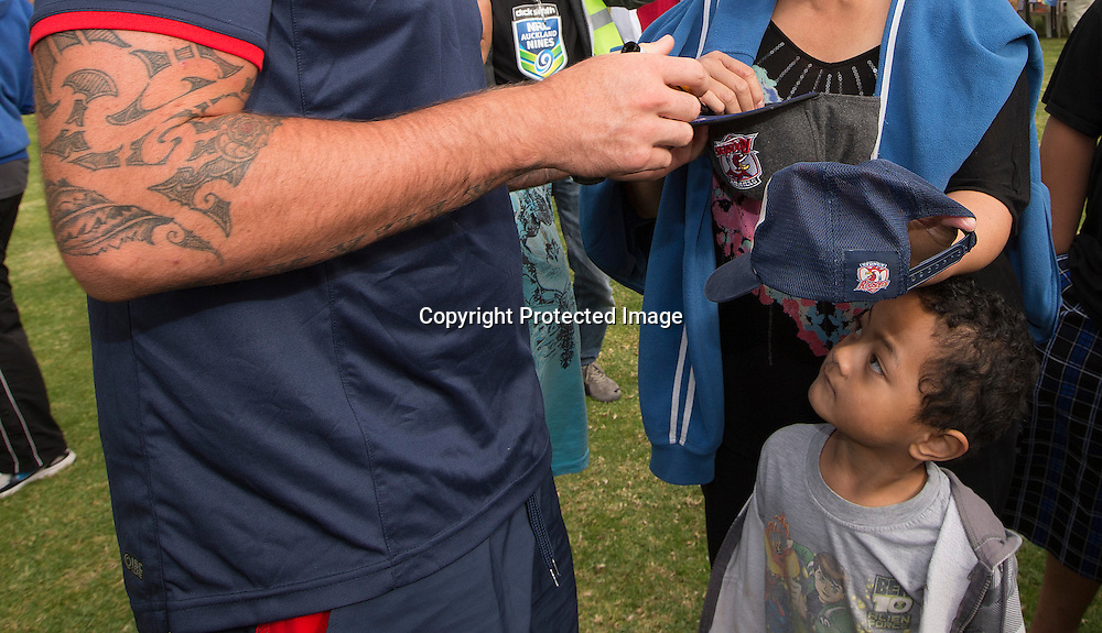 A youngster looks up a Shaun Kenny-Dowall as he signs autographs during the visit by the Sydney Roosters NRL Nines Rugby league team  to the Te Atatu Roosters Rugby League club in West Auckland, New Zealand. <br /> Picture; www.photosport.co.nz