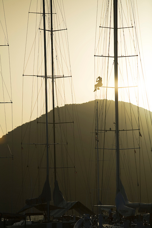 during the 2008 Antigua Classic Yacht Regatta . This race is one of the worlds most prestigious traditional yacht races. It takes place annually off the cost of Antigua in the British West Indies. Antigua is a yachting haven, historically a British navy base in the times of Nelson. A crew member works aloft in the rigging , inspecting and repairing in preparation for the 2008 Antigua Sailing Week.This race is one of the worlds most prestigious  yacht races. It takes place annually off the cost of Antigua in the British West Indies. Antigua is a yachting haven, historically a British navy base in the times of Nelson.