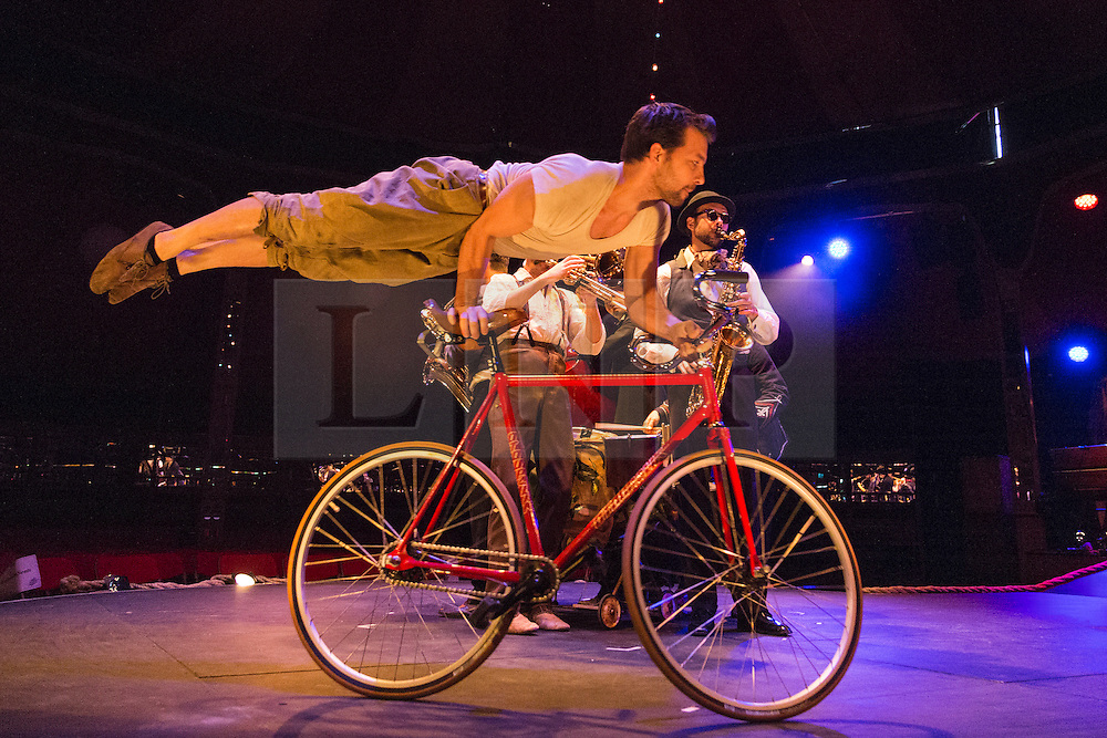 © Licensed to London News Pictures. 19/05/2015. London, UK. Bike stunts with Davir Carberry, Kate Muntz and Chelsea McGuffin, accompanied by Ben Walsh's Crusty Suitcase Band. The show Scotch & Soda headlines London Wonderground from 14 May to 2 August 2015 as Underbelly and Southbank Centre present a 4th summer of entertainment.  Photo credit : Bettina Strenske/LNP