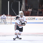 Colton Saucerman #23 of the Northeastern Huskies calls for the puck during the game at Matthews Arena on January 18, 2014 in Boston, Massachusetts. (Photo by Elan Kawesch)
