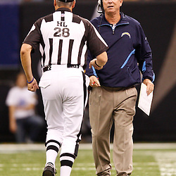 August 27, 2010; New Orleans, LA, USA; San Diego Chargers head coach Norv Turner talks to head linesman Mark Hittner (28) during the first half of a preseason game at the Louisiana Superdome. The New Orleans Saints defeated the San Diego Chargers 36-21. Mandatory Credit: Derick E. Hingle