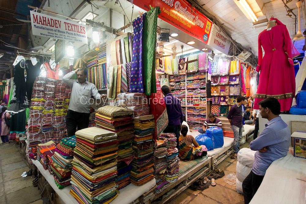 Stall selling textiles. near Mangaldas Market. Mumbai.