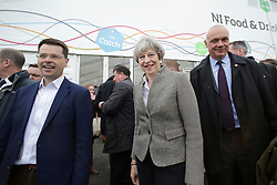 © Licensed to London News Pictures. 13/05/2017. Lisburn, UK. British prime minister THERESA MAY during a visit to Balmoral Show at Balmoral Park in Lisburn, Northern Ireland, with Secretary of State for Northern Ireland JAMES BROKENSHIRE (left), while campaigning ahead of a general election which takes place on June 8, 2017.  Photo credit: Kalista McErlane/LNP