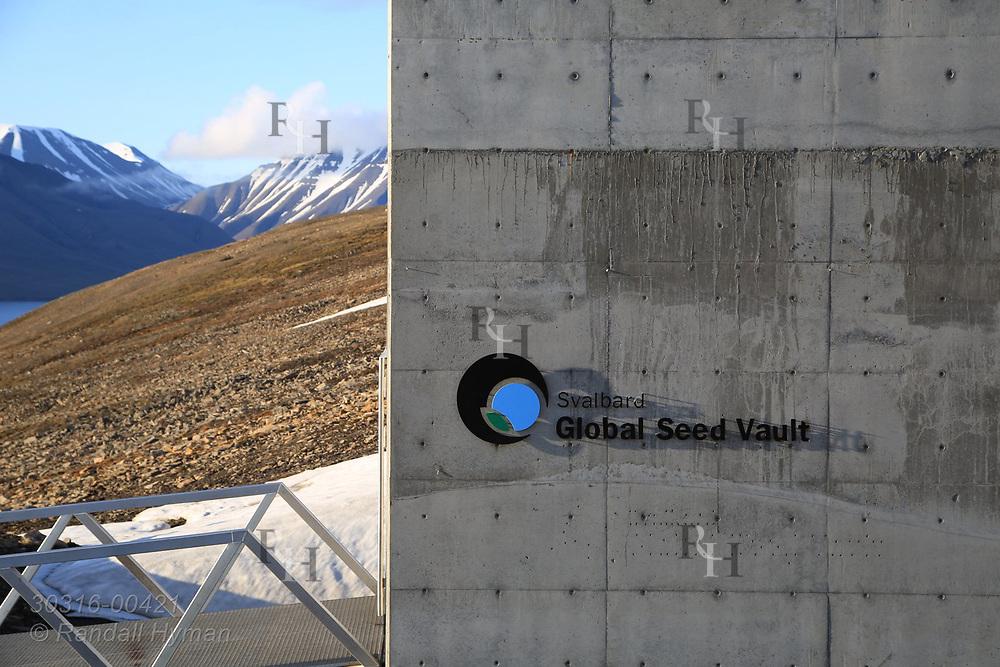 Global Seed Vault juts from rocky hillside in mid summer in Longyearbyen on Spitsbergen island, Svalbard, Norway.