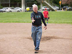 League founder Lewis Dolinsky throws out the ceremonial first pitch as the Montclair softball league celebrates its 50th season, Saturday, April 22, 2017, at Montclair Park in Oakland, Calif. The pickup softball game, played every Saturday by a group of enthusiasts ranging in age from 20 to 75, started in 1968 in Berkeley and moved to Montclair about 25 years ago. (Photo by D. Ross Cameron)
