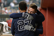 PHOENIX, AZ - JULY 26:  Matt Kemp #27 and Freddie Freeman #5 of the Atlanta Braves hug in the dugout prior to the MLB game against the Arizona Diamondbacks at Chase Field on July 26, 2017 in Phoenix, Arizona.  (Photo by Jennifer Stewart/Getty Images)