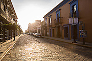 Early morning street scene in the historic district Oaxaca, Mexico.