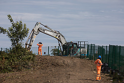 Harefield, UK. 13 July, 2020. Ground clearance work in the Colne Valley for the HS2 high-speed rail link. Thousands of trees have already been felled for the project in the Colne Valley.
