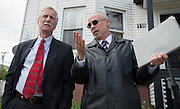 Sen. Angus King speaks with Lewiston Deputy City Administrator Phil Nadeu at the site of the May 6 fire on Bartlett Street in Lewiston, Maine on May 17, 2013. The fire was the third of three arsons in one week within three blocks of each other in downtown Lewiston.