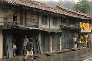 Town of Hinguala on the Kandy Road. Kaushik in shorts walking towards Channa Daswatta taking photos of something!