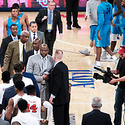 January 9, 2018, New York, NY : Georgetown head coach Patrick Ewing, at center left in grey suit, shakes hands with St. John's head coach Chris Mullin, at center right in black suit, at the conclusion of Tuesday night's matchup between the Hoyas and Red Storm at the Garden. In something of a rematch of their 1985 contest, Basketball greats Patrick Ewing and Chris Mullin returned to Madison Square Garden on Tuesday night to face off as coaches with their respective Georgetown and St. John's teams.  CREDIT: Karsten Moran for The New York Times