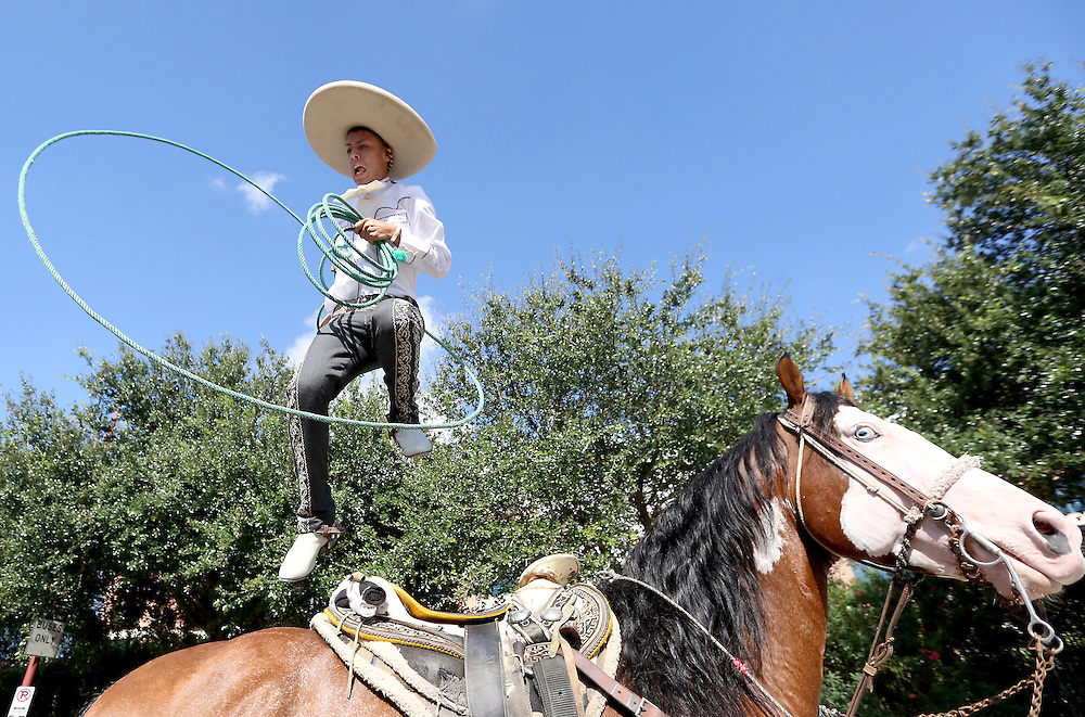 Erik Flores, age 19 practices trick roping before participating in the 47th Fiestas Patrias International Parade on Saturday 19, 2015 in Houston, TX. <br /> <br /> The parade began on Texas at Jackson, and proceeded west on Texas, south on San Jacinto, east on Preston and concluded on Preston at Crawford. This International Parade is held to honor Latin American countries of Brazil, El Salvador, Costa<br /> Rica, Honduras, Guatemala, Nicaragua, Mexico, Chile, and Belize, which celebrate their independence during the month of September. <br /> <br /> Thomas B. Shea / Houston Chronicle