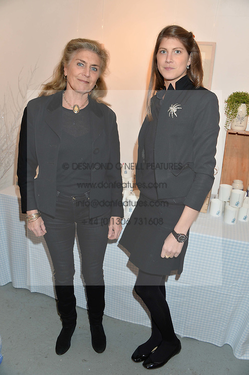Left to right, PRINCESS VICTORIA VON PREUSSEN and daughter PRINCESS FLORENCE VON PREUSSEN at an exhibition of works by Beatrice von Preussen held at The Gallery on The Corner, 155 Battersea Park Road, London SW8 on 11th December 2013.