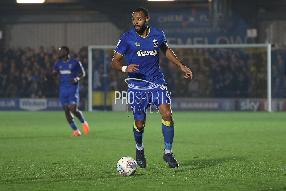 AFC Wimbledon midfielder Liam Trotter (14) dribbling during the EFL Sky Bet League 1 match between AFC Wimbledon and Charlton Athletic at the Cherry Red Records Stadium, Kingston, England on 10 April 2018. Picture by Matthew Redman.