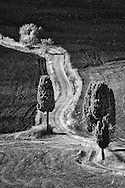 Infra Red Black & White view of winding road across agricultural fields, near Pienza, Italy, Tuscany