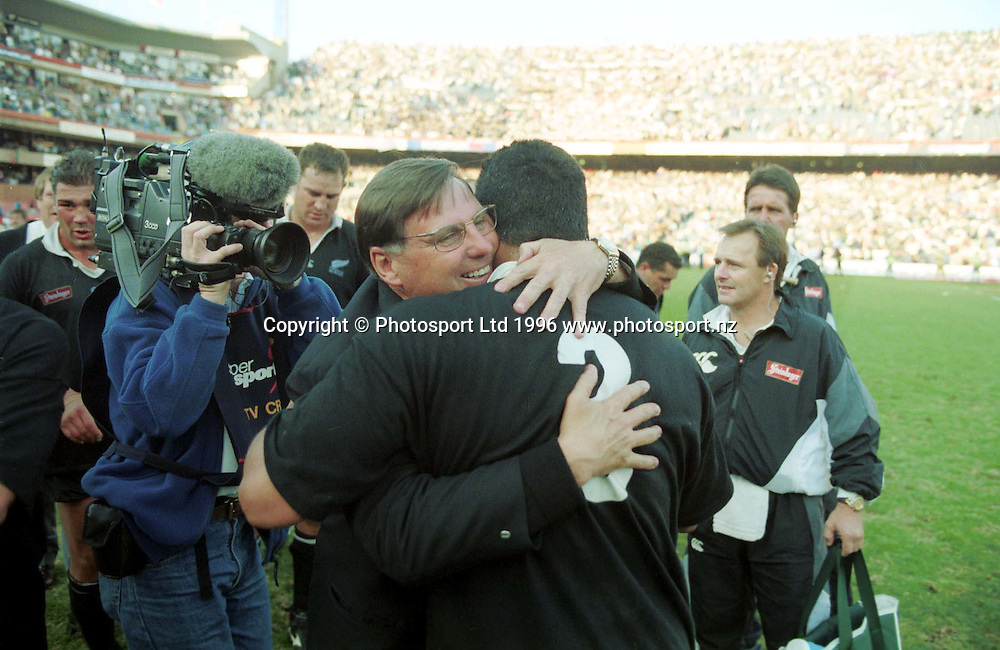 John Hart and Olo Brown celebrate with a hug after the series win, All Blacks v South Africa, New Zealand Tour of South Africa, 24 August 1996. Photo: Andrew Cornaga/PHOTOSPORT
