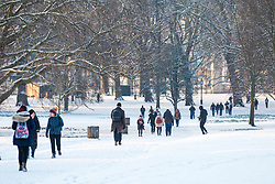 © Licensed to London News Pictures. 28/02/2018. London, UK. People walk through Green Park in London after heavy overnight snowfall as the 'Beast from the East brings freezing Siberian air to the UK. Photo credit: Rob Pinney/LNP