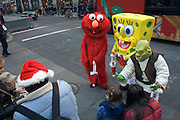 Sponge Bob Square Pants and other Cartoon characters entertaining crowd during Christmas shopping time