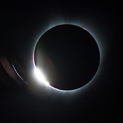 As the last portion of the sun remains visible during a Total Solar Eclipse, the eclipse looks like a diamond ring.  The solar flares on the sun just become visible at this point.  Captured on August 21, 2017 in Salem, Oregon.