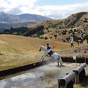 Laura Hewitson riding Monarch of the Glen in action at the water jump during the Cross Country event at the Wakatipu One Day Horse Trials at the Pony Club grounds,  Queenstown, Otago, New Zealand. 15th January 2012. Photo Tim Clayton
